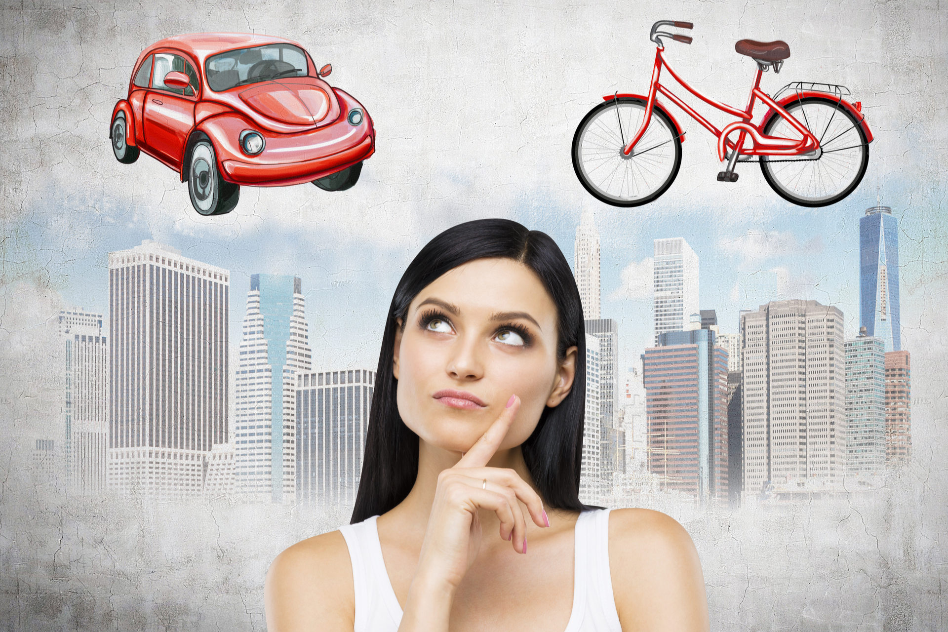 young brunette woman considering car or bike for getting around the city