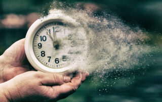 Retro alarm clock concept shows clock that is dissolving away into little particles