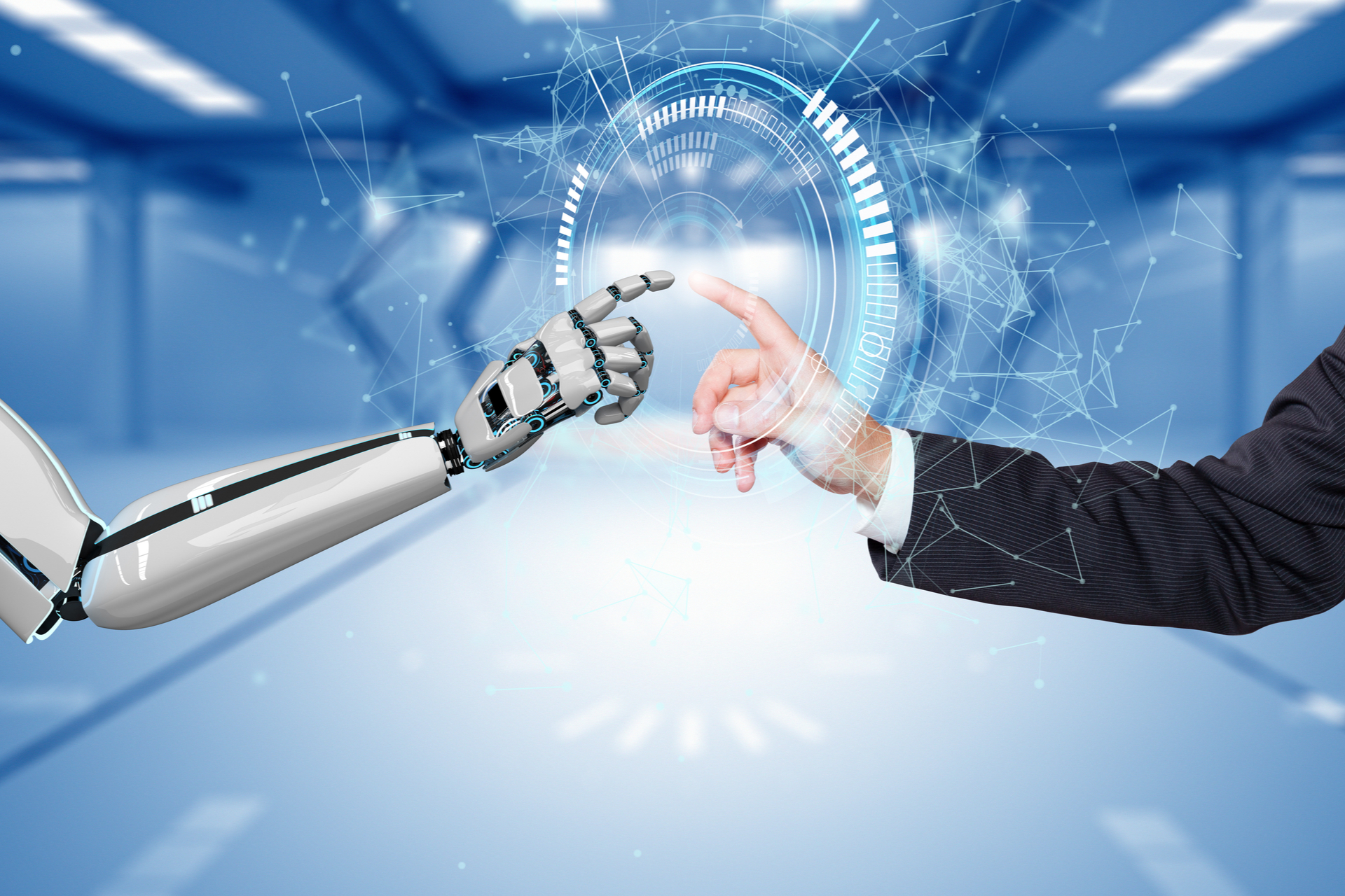 robot hand and a human hand touch each other